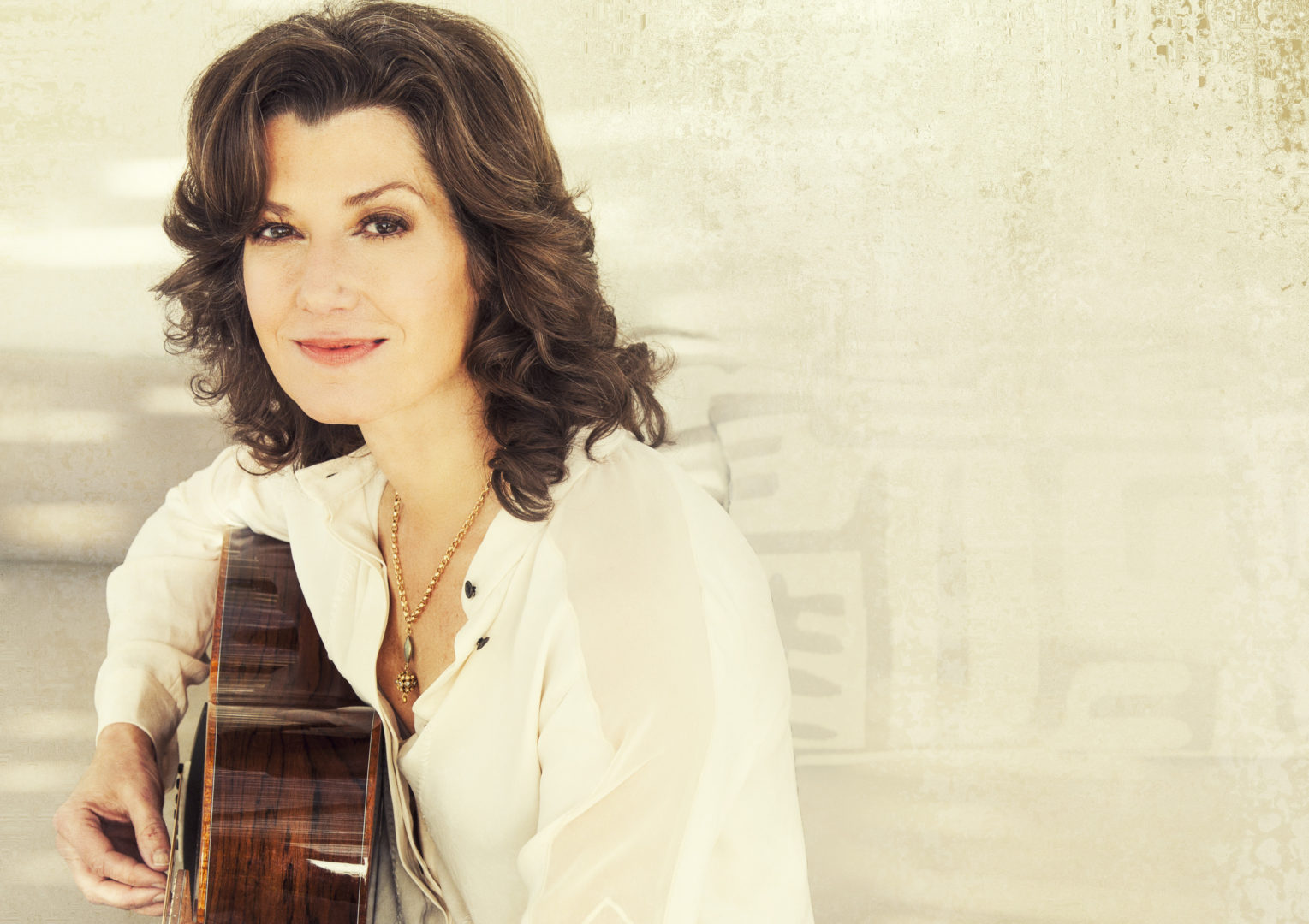 Picture of Amy Grant with her guitar used in an article for an upcoming Franklin TN event