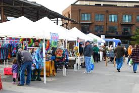 People shopping in downtown Franklin, TN at the Franklin Farmers Market, find antiques, fun activities for kids and family and more!